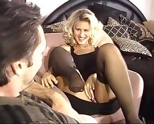 Busty golden-haired milf fucking in dark nylons