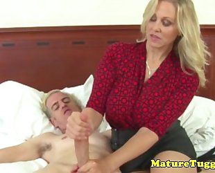 Busty older milf acquires cum on titties after hj