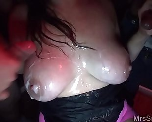 Hotwife engulfing a room full of cocks