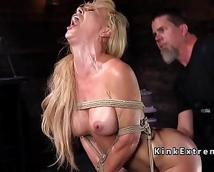Hogtied golden-haired hanged in rope servitude