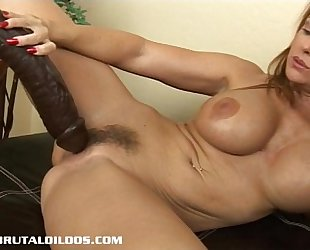 Busty milf janet taking each foot of a large brutal sex-toy