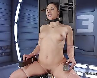 Brunette in slavery fucking machine